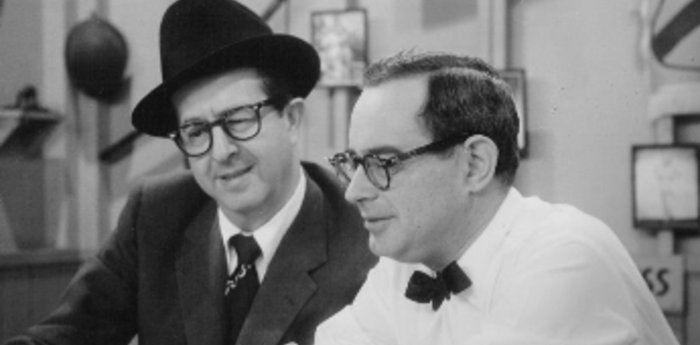 Phil Silvers and Nat Hiken look over a script.